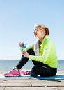 Woman resting after doing sports outdoors sport and lifestyle concept Stock Photo