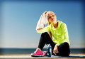 Woman resting after doing sports outdoors sport and lifestyle concept Stock Photography