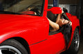 Woman resting in the red car. Royalty Free Stock Photo