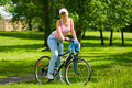 Woman rests on the bike Royalty Free Stock Photos