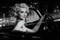 Woman in retro car against with red lips night city Stock Image