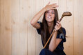 Woman with retro golf stick Stock Photography