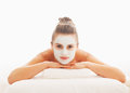 Woman with revitalising mask on face laying on massage table young Royalty Free Stock Photography