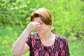 Woman with rhinitis in summer park the Royalty Free Stock Photography