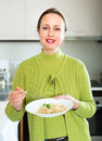 Woman with rice in kitchen Royalty Free Stock Photo