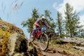 Woman rider downhill mountain biking Royalty Free Stock Photo