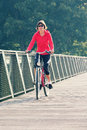 Woman rides bicycle Royalty Free Stock Photography