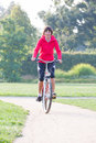 Woman rides a bicycle around the city park Royalty Free Stock Photography