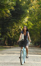 Woman Riding A Bicycle Stock Image