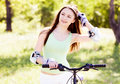 Woman riding a bicycle Royalty Free Stock Images