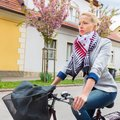 Woman riding bicycle talking on cell phone while to work environmentally friendly and healthy way of urban transportation Stock Photography