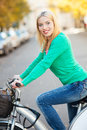 Woman riding a bike in the city Stock Photography