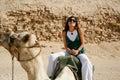Woman riding camel Royalty Free Stock Photo