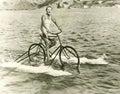 Woman riding cycle boat on lake Royalty Free Stock Photo