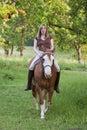 Woman riding her horse bareback Royalty Free Stock Photo