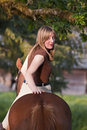 Woman riding her horse bareback Royalty Free Stock Image