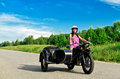 Woman riding a motorcycle. Royalty Free Stock Photo