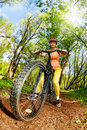Woman riding a mountain bike on forest trail Royalty Free Stock Photo