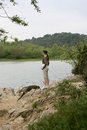 Woman on a riverbank stood Royalty Free Stock Image