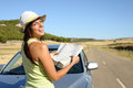 Woman on road trip looking map young car travel in spain brunette hispanic girl having fun summer journey Stock Image