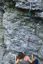 Woman rock climber on the cliff