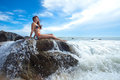 Woman on the rock in ocean Royalty Free Stock Images