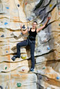Woman on rock wall Stock Photos