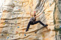 Woman on rock wall active young in sport center Royalty Free Stock Photo