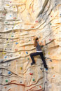 Woman on rock wall active young in sport center Royalty Free Stock Image