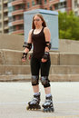 Woman Rollerblades On Urban Street Royalty Free Stock Images