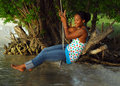 Woman on rope swing Royalty Free Stock Images