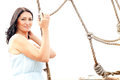Woman and ropes beautiful adult in a dress holding on to Royalty Free Stock Photo