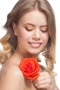 Woman with rose and beautiful make-up Stock Images