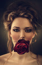 Woman with rose and drops in hair Royalty Free Stock Photo
