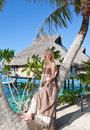 Woman with a rose at a palm tree. Bora-bora, Stock Photo