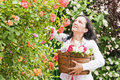 Woman with roses in garden Royalty Free Stock Photo