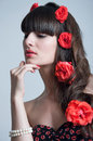 Woman with roses in hair studio portrait of beautiful sensual young model red lips elegant long brunette weaved into waves big Royalty Free Stock Images
