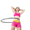 Woman rotates hula hoop young indoor background Royalty Free Stock Photos