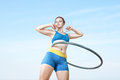 Woman rotates hula hoop Royalty Free Stock Photo