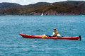 Woman rows a sea kayak in the bay of island new zealand very popular travel destination of nz Stock Image