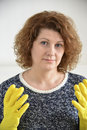 Woman with rubber gloves on his hands Royalty Free Stock Photo