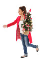 Woman run with christmas tree young on eve isolated on white Royalty Free Stock Photo