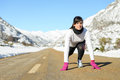Woman run in winter landscape road Stock Photography