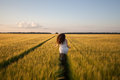 Woman run  in yellow wheat field Royalty Free Stock Photo