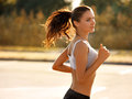 Woman Runner. Fitness Girl Running outdoors Royalty Free Stock Photo