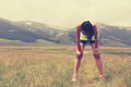 Woman runner have a break nature trail tired young fitness Stock Image