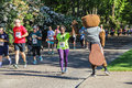Woman runner high fives osu mascot during k charity run corvallis or may x s benny the beaver for center against rape and domestic Royalty Free Stock Photo