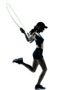 Woman runner jogger jumping rope one caucasian in silhouette studio isolated on white background Stock Photography