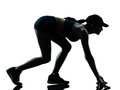 Woman runner jogger on the starting block Royalty Free Stock Photo