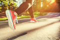 Woman runner jogging down an outdoor trail Royalty Free Stock Photo